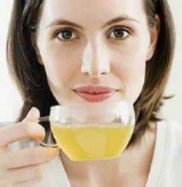 Woman drinking green tea