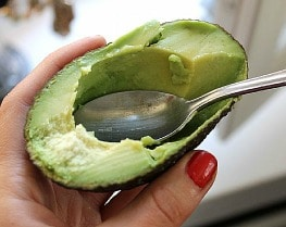 eating avocado